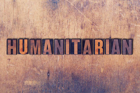 letterpress words: The word Humanitarian concept and theme written in vintage wooden letterpress type on a grunge background. Stock Photo
