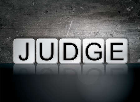 deduce: The word Judge concept and theme written in white tiles on a dark background.