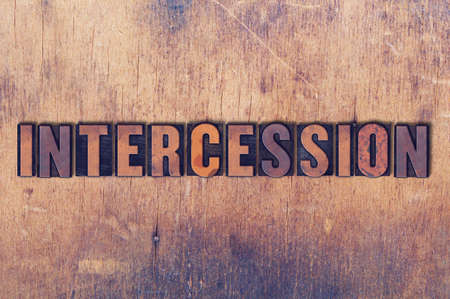 letterpress words: The word Inercession concept and theme written in vintage wooden letterpress type on a grunge background. Stock Photo