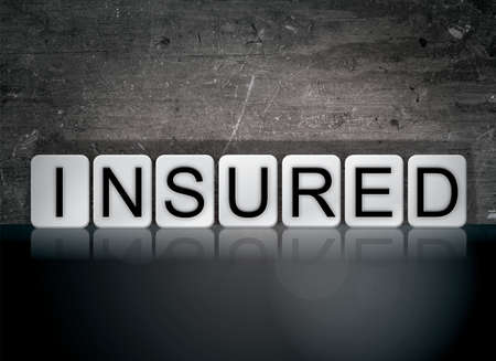 safeguarded: The word Insured concept and theme written in white tiles on a dark background.