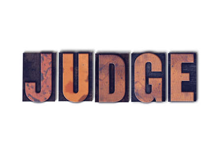 deduce: The word Judge concept and theme written in vintage wooden letterpress type on a white background.