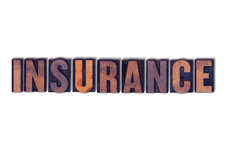 white backing: The word Insurance concept and theme written in vintage wooden letterpress type on a white background.