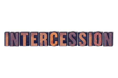 The word Inercession concept and theme written in vintage wooden letterpress type on a white background.