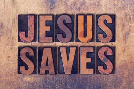 The words Jesus Saves concept and theme written in vintage wooden letterpress type on a grunge background.