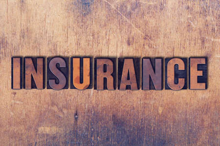 letterpress words: The word Insurance concept and theme written in vintage wooden letterpress type on a grunge background. Stock Photo