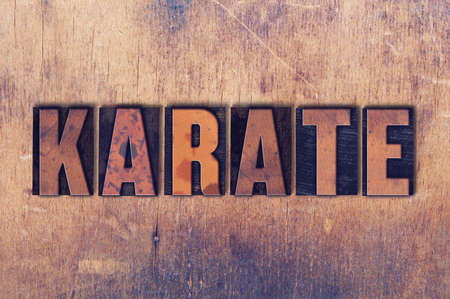 letterpress words: The word Karate concept and theme written in vintage wooden letterpress type on a grunge background. Stock Photo