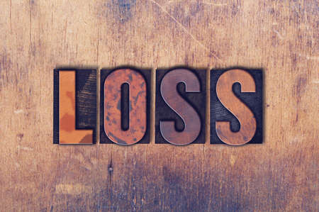 The word Loss concept and theme written in vintage wooden letterpress type on a grunge background.