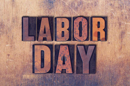 The holiday Labor Day concept and theme written in vintage wooden letterpress type on a grunge background. Фото со стока