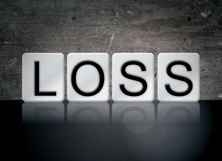 The word Loss concept and theme written in white tiles on a dark background.