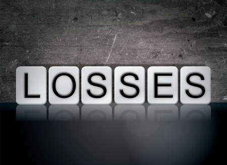 単語の損失の概念と暗い背景に白のタイルで書かれたテーマ。