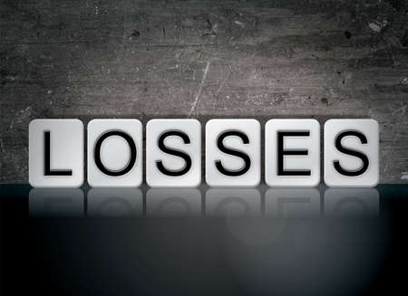 The word Losses concept and theme written in white tiles on a dark background. Banco de Imagens