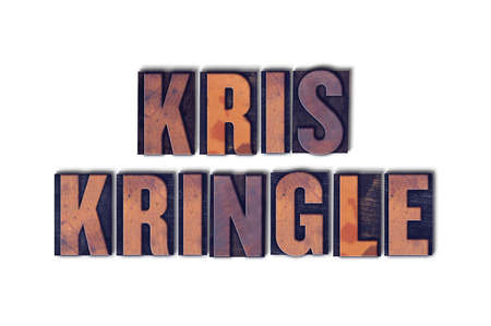 kris kringle: The name Kris Kringle concept and theme written in vintage wooden letterpress type on a white background.