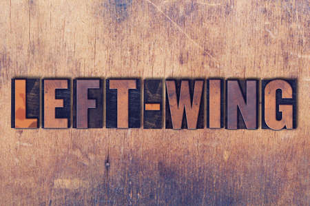 The word Left-Wing concept and theme written in vintage wooden letterpress type on a grunge background.