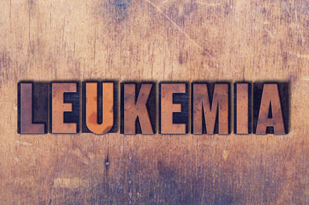 The word Leukemia concept and theme written in vintage wooden letterpress type on a grunge background.