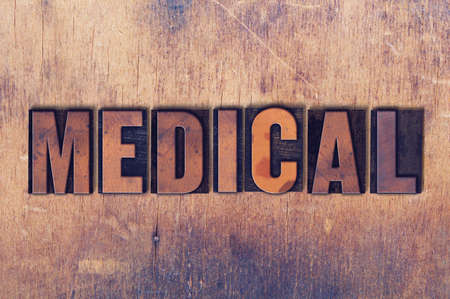 letterpress words: The word Medical concept and theme written in vintage wooden letterpress type on a grunge background. Stock Photo