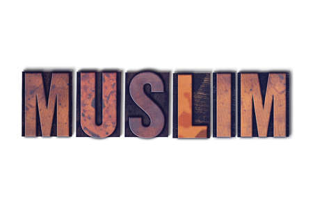 letterpress words: The word Muslim concept and theme written in vintage wooden letterpress type on a white background.