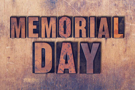 The holiday Memorial Day concept and theme written in vintage wooden letterpress type on a grunge background. Фото со стока