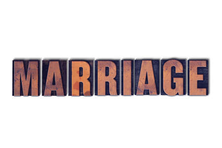 The word Marriage concept and theme written in vintage wooden letterpress type on a white background. 版權商用圖片
