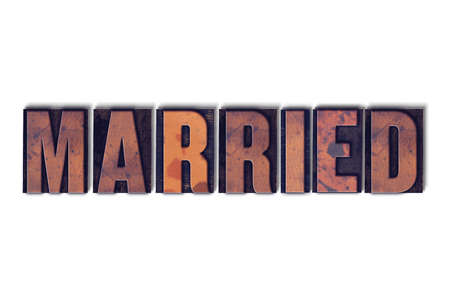 The word Married concept and theme written in vintage wooden letterpress type on a white background. Banco de Imagens
