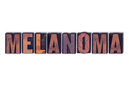 letterpress words: The word Melanoma concept and theme written in vintage wooden letterpress type on a white background.
