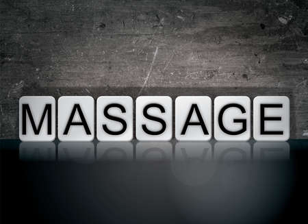 The word Massage concept and theme written in white tiles on a dark background.