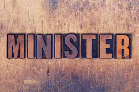 The word Minister concept and theme written in vintage wooden letterpress type on a grunge background. Stock Photo - 82404382