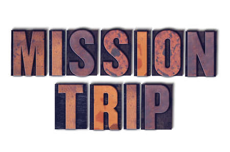 The words Mission Trip concept and theme written in vintage wooden letterpress type on a white background.