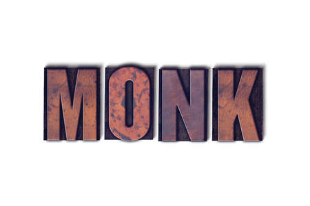 The word Monk concept and theme written in vintage wooden letterpress type on a white background. 版權商用圖片