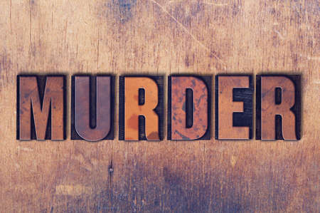 letterpress words: The word Murder concept and theme written in vintage wooden letterpress type on a grunge background. Stock Photo