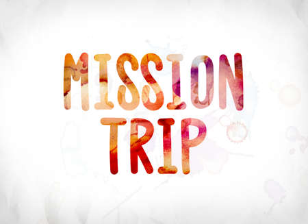 The words Mission Trip concept and theme painted in colorful watercolors on a white paper background. Stock fotó