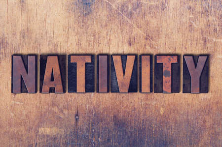 letterpress words: The word Nativity concept and theme written in vintage wooden letterpress type on a grunge background.