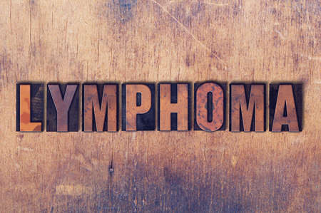 tumors: The word Lymphoma concept and theme written in vintage wooden letterpress type on a grunge background.