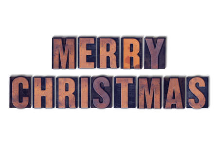 letterpress words: The words Merry Christmas concept and theme written in vintage wooden letterpress type on a white background. Stock Photo