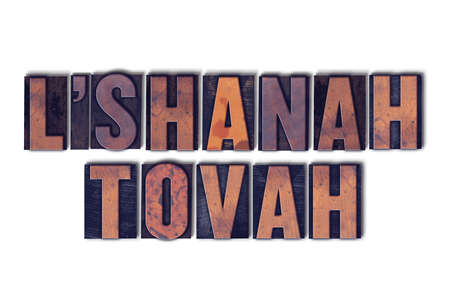 letterpress words: The words LShanah Tovah concept and theme written in vintage wooden letterpress type on a white background. Stock Photo