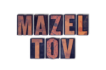 The words Mazel Tov concept and theme written in vintage wooden letterpress type on a white background. Banco de Imagens
