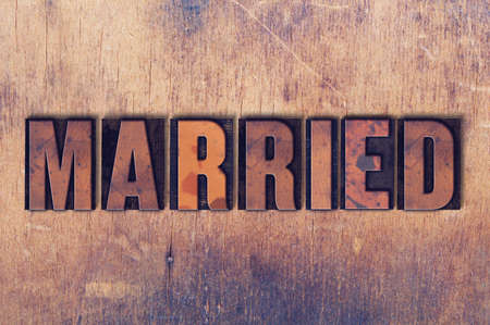 The word Married concept and theme written in vintage wooden letterpress type on a grunge background.