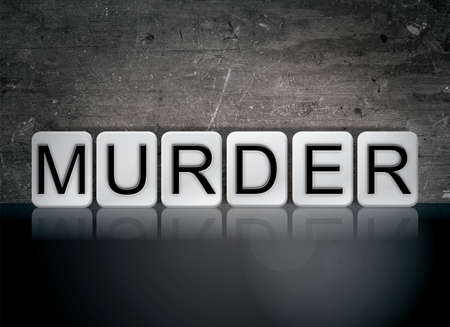 The word Murder concept and theme written in white tiles on a dark background. Stock Photo