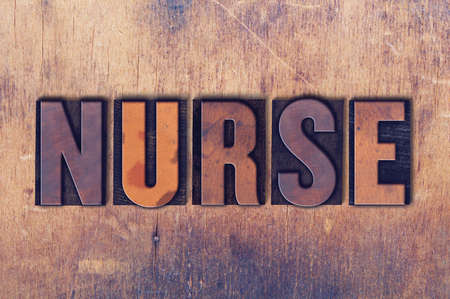 The word Nurse concept and theme written in vintage wooden letterpress type on a grunge background.