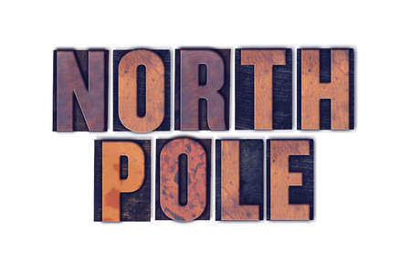 elves: The words North Pole concept and theme written in vintage wooden letterpress type on a white background.