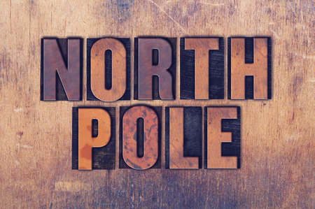 letterpress words: The words North Pole concept and theme written in vintage wooden letterpress type on a grunge background.