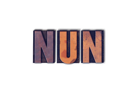 letterpress words: The word Nun concept and theme written in vintage wooden letterpress type on a white background. Stock Photo