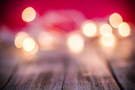 An abstract red background of glowing bokeh lights. Imagens