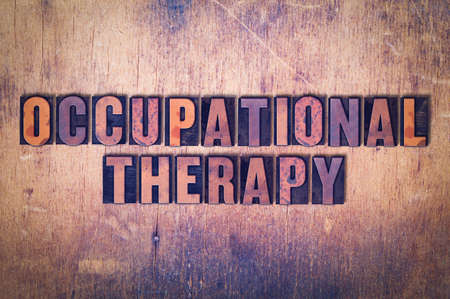 The words Occupational Therapy concept and theme written in vintage wooden letterpress type on a grunge background.