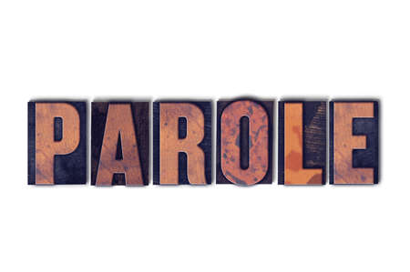 The word Parole concept and theme written in vintage wooden letterpress type on a white background.