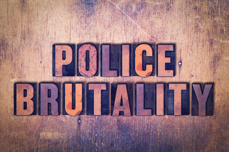 The words Police Brutality concept and theme written in vintage wooden letterpress type on a grunge background. Stock Photo