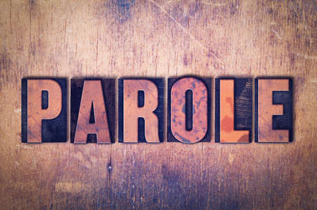 The word Parole concept and theme written in vintage wooden letterpress type on a grunge background.