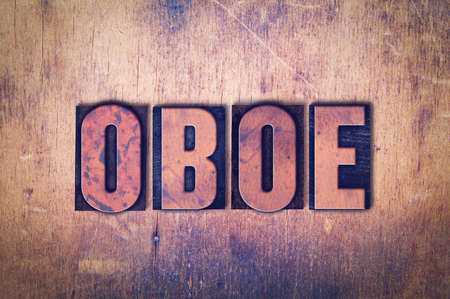 The word OBOE concept and theme written in vintage wooden letterpress type on a grunge background.