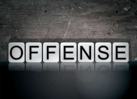 The word Offense concept and theme written in white tiles on a dark background.