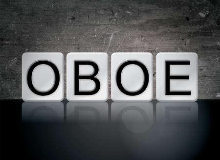 단어 OBOE 개념 및 어두운 배경에 흰색 타일에서 작성 된 테마.