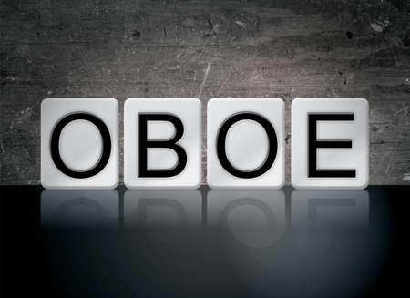 The word OBOE concept and theme written in white tiles on a dark background. Stock Photo